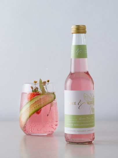 A bottle and glass of strawberry, cucumber and limeflower drink from Tame and Wild Drinks